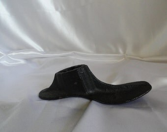 Heavy metal shoe mold used by shoe repair man, used to put inside shoe and make repairs.