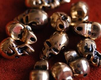 """Gold Skull plastic parts 0.9""""x0.47"""" 25 pcs"""
