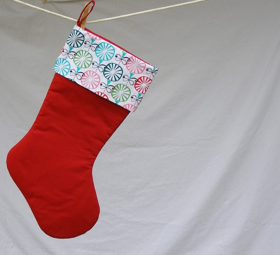 Modern christmas stocking red fabric with colorful abstract ornament