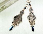 Copper earrings with oriental pattern.