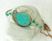 Copper paisley necklace with green blue patina.