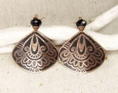 Copper earrings with oriental pattern.
