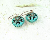 Copper filigree earrings with green blue patina.