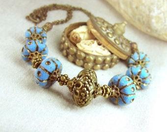 Brass blue ethnic necklace.