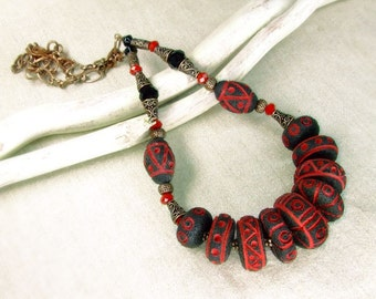 Black and red ethnic necklace.