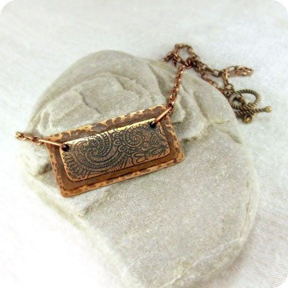 Copper rustic pendant with oriental pattern.