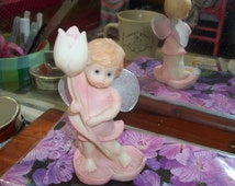 Fairy figurine pink dress barefoot girl holding flower figurine with netted wings