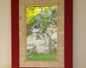 Red Framed Mirror with Natural Tile