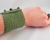 Green Cotton Knitted Cuff: cool green cuff with red tiger eye buttons, under 30, wristwarmer, knitted bracelet