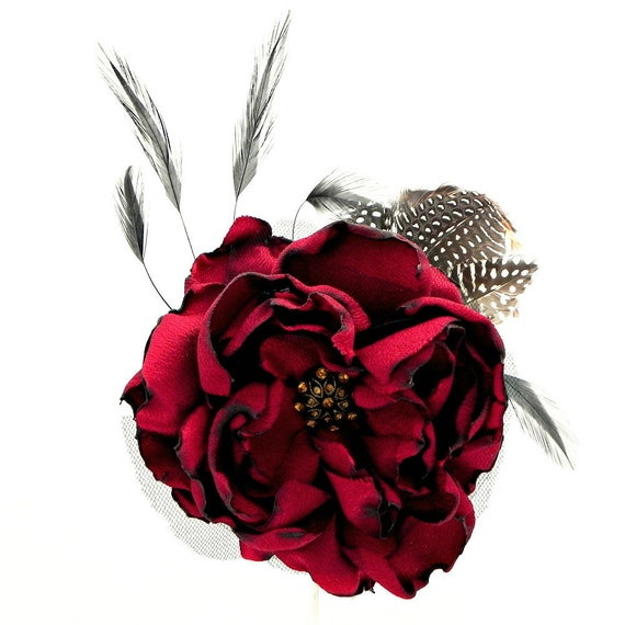 Hair Flower Fascinator: deep red large fabric flower with bronze and topaz centre and black, white and brown feathers hair clip