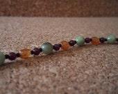 Hessonite garnet, green garnet, red garnet, Czech glass and sterling silver bracelet-It's All Garnets