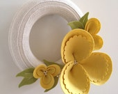 Spring wreath, felt blossom and upcycled sweater, yellow on cream