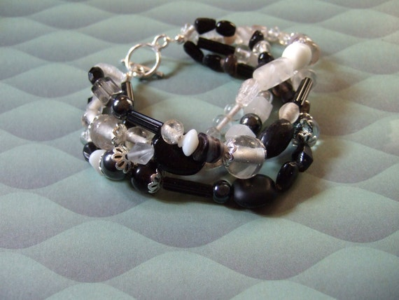 Black, White, clear and frosted bracelet with toggle clasp