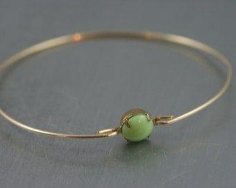 Single stone lime green gold modern  bangle