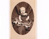 1870's Carte De Visite Photograph of Very Cute Victorian Baby in a Dark Dress with Light Trim, Hidden Mother