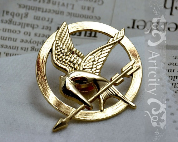 Brooch---GOLDEN The Hunger Games Inspired Mockingjay brooch with a pin at the back