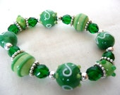 Beautiful Green Lampwork Bracelet--Sparkly Emerald Faceted Rounds, Lampwork Beads, Silver Rounds, Beaded Rondelles. Cute.