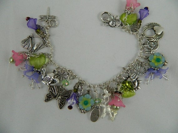 Beautiful garden themed charm bracelet fully loaded lucite flowers silver toned charms watering can butterfly bee snail sun birds dragonfly
