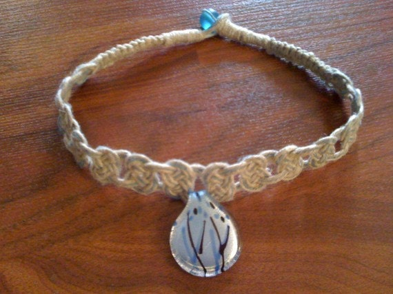 Blue glass pendant on Josephine knot hemp necklace