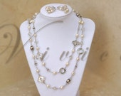 Reserved Listing for Sahara for initial deposit/payment only.  Swarovski crystal and freshwater pearls necklace and earrings set.