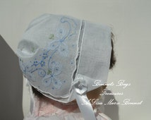Heirloom Baby Bonnet  Embroidered with light blue Riboons and  flowers great gift for baby showers Christening and Dedications