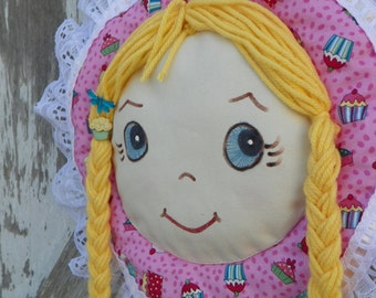 Barrette Holder with Blue Eyes long Yellow braids and Cupcake and Dragonfly accent Bonnet is Pink with cupcake pattern trimmed with lace