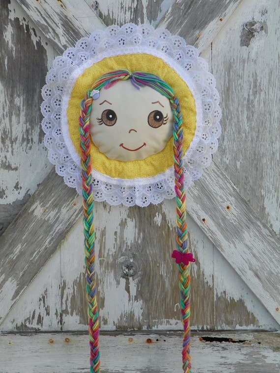 Barrette Holder with Brown Eyes long multi colored braids and  cupcake accent Yellow Bonnet trimmed with lace