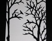 Paper cut silhouette: Birds in trees