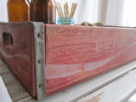 vintage wooden coca cola soda crate and rope