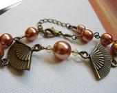 Asian Inspired Bracelet, fan bracelet,Asian oxidized gold fan, butterscotch pearl bracelet