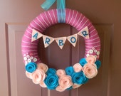 Baby Wreath - Nursery Wreath - Fuchsia yarn wrapped wreath with felt flowers in baby pink and peacock.