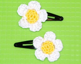 pair of crocheted flowers hair clips