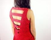 Red dress with black dots and cut out back detail
