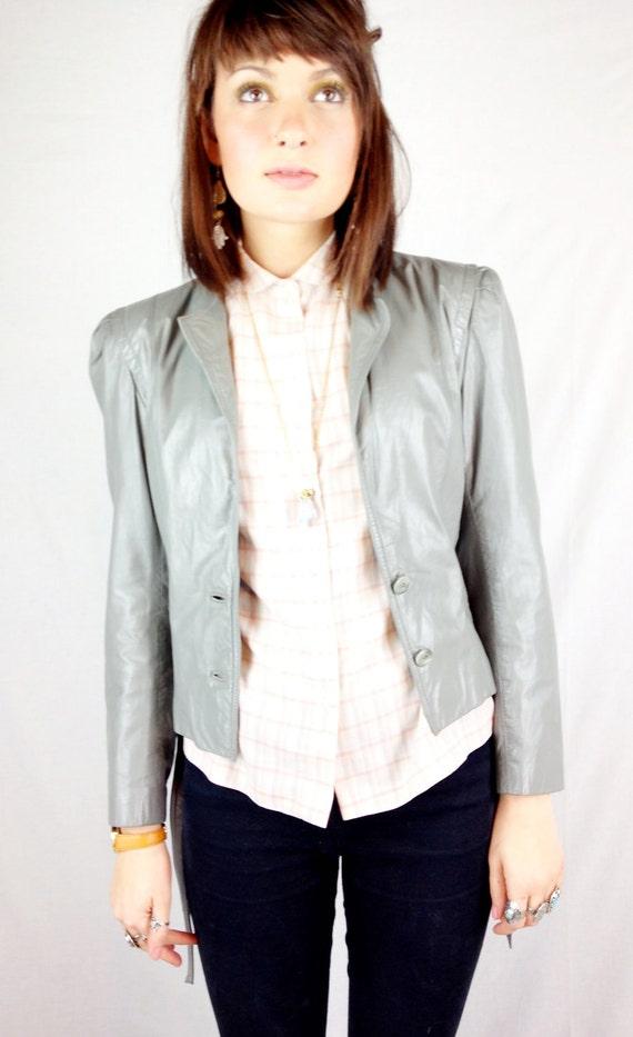 1980's Grey Wilsons Leather Jacket. razor sharp shoulders.