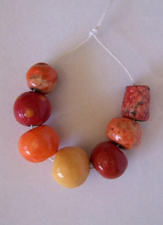 Handmade ceramic beads, orange, red, yellow