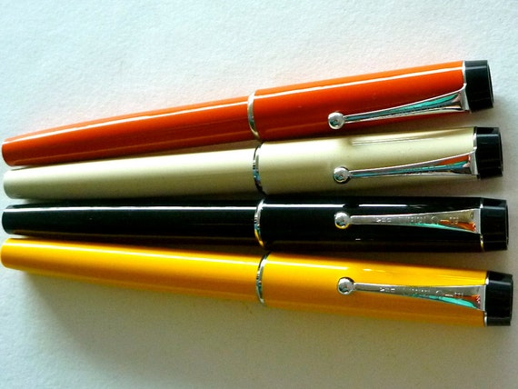 circa 1970 1 Parker Big Red Pen, new/old, Orange, White, Black.