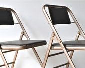 Mid Century metal and vinyl folding chairs industrial mad men