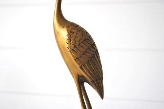 Tall brass crane