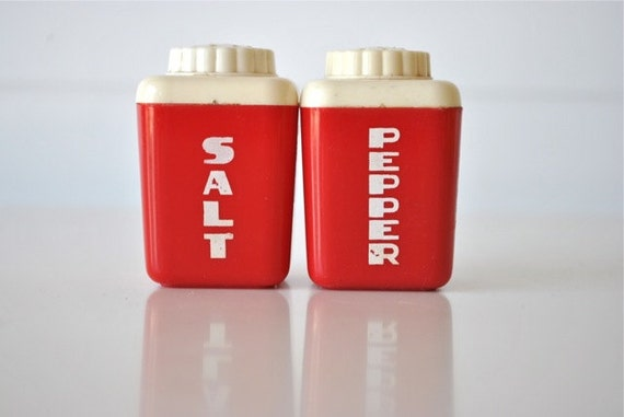 Bright red little salt and pepper shakers