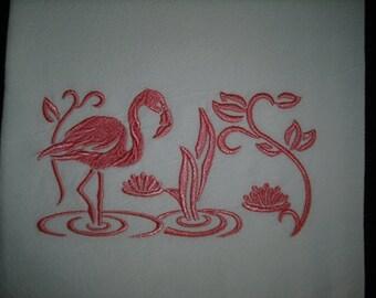 Flamingo machine embroidered flour sack towels.