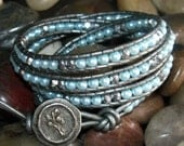 Light Blue Glass Pearls with Silver Accents on Metallic Grey Leather