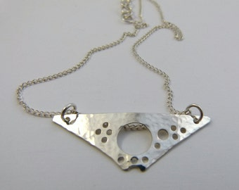Triangular argentium sterling silver cut out pendant