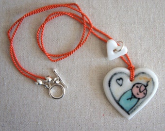 Baby Love: heart-shaped porcelain pendant necklace, hand-modelled and hand-painted