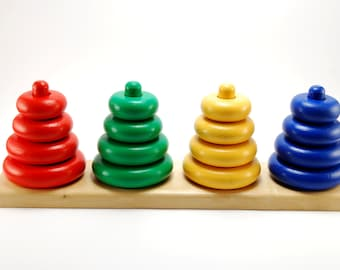 Developing wooden pyramid set - stacking and sorting toy for children ages 1-3 years.
