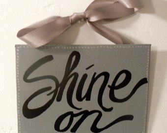 Hand-painted 5x7 canvas plaque with ribbon.  SHINE ON