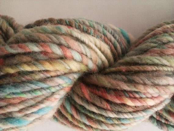 Subdued rainbow. Handspun, hand painted art yarn.   Pure Australian merino wool 21 micron, 3 ply.