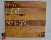 What I love most about my home is whom i share it with, wood sign