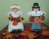 Thanksgiving couple holding garland, handpainted, pumpkins, apples, sunflowers