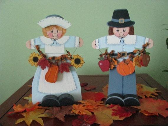 Thanksgiving couple holding garland, handpainted, pumpkins, apples, sunflowers