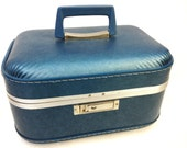 vintage 1970's blue train case with mirror. (10% donated to charity)